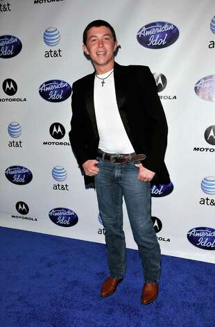 "HOLLYWOOD, CA - FEBRUARY 24:  ""American Idol"" 2011 contestant Scotty McCreery arrives at Idol Prom: The ""American Idol"" Season Ten Top 24 Debut event at the Roosevelt Hotel on February 24, 2011 in Hollywood, California.  (Photo by Michael Tullberg/Getty Images) *** Local Caption *** Scotty McCreary Photo: Michael Tullberg, Getty Images / 2011 Michael Tullberg"