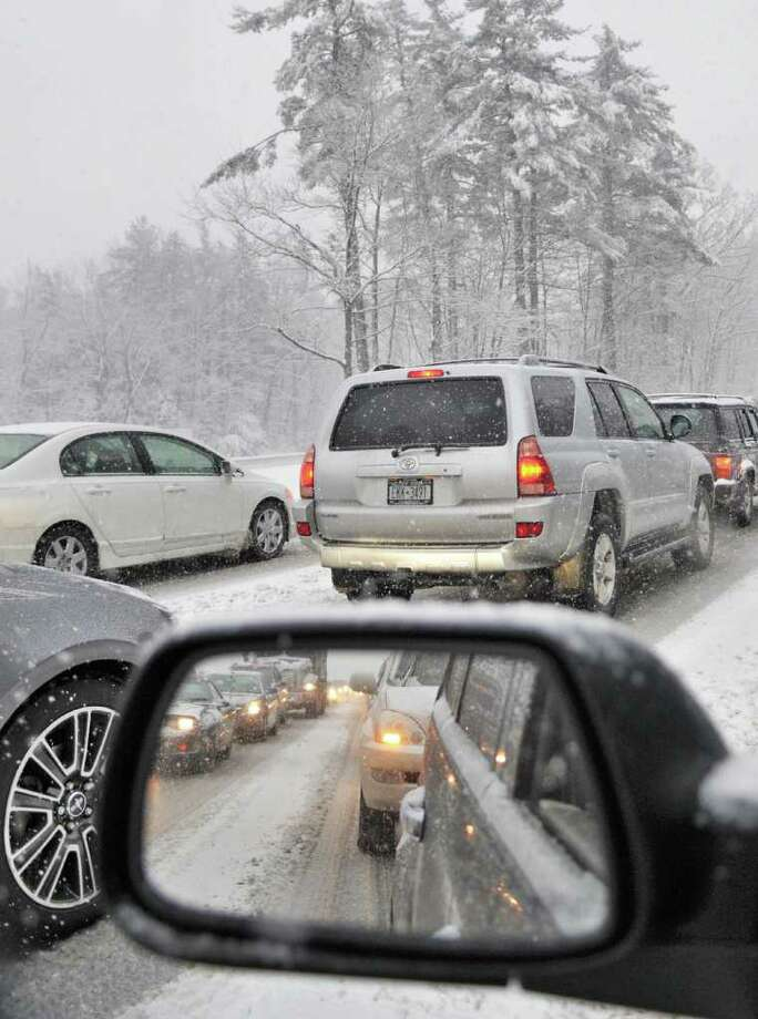 Southbound traffic on I87 slogs through a snowstorm  in Clifton Park Friday morning Feb. 25, 2011.  (John Carl D'Annibale / Times Union) Photo: John Carl D'Annibale / 00012200A