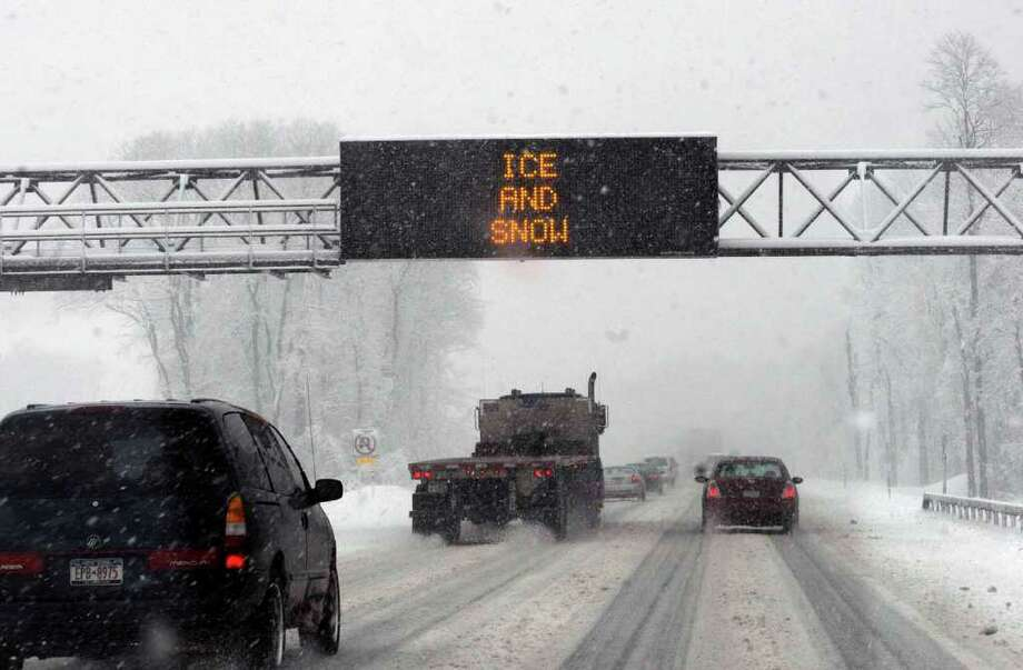 An ice and snow advisory on the Thruway between exits 24 and 25 westbound Friday Feb. 25, 2011. ( Michael P. Farrell/Times Union ) Photo: Michael P. Farrell