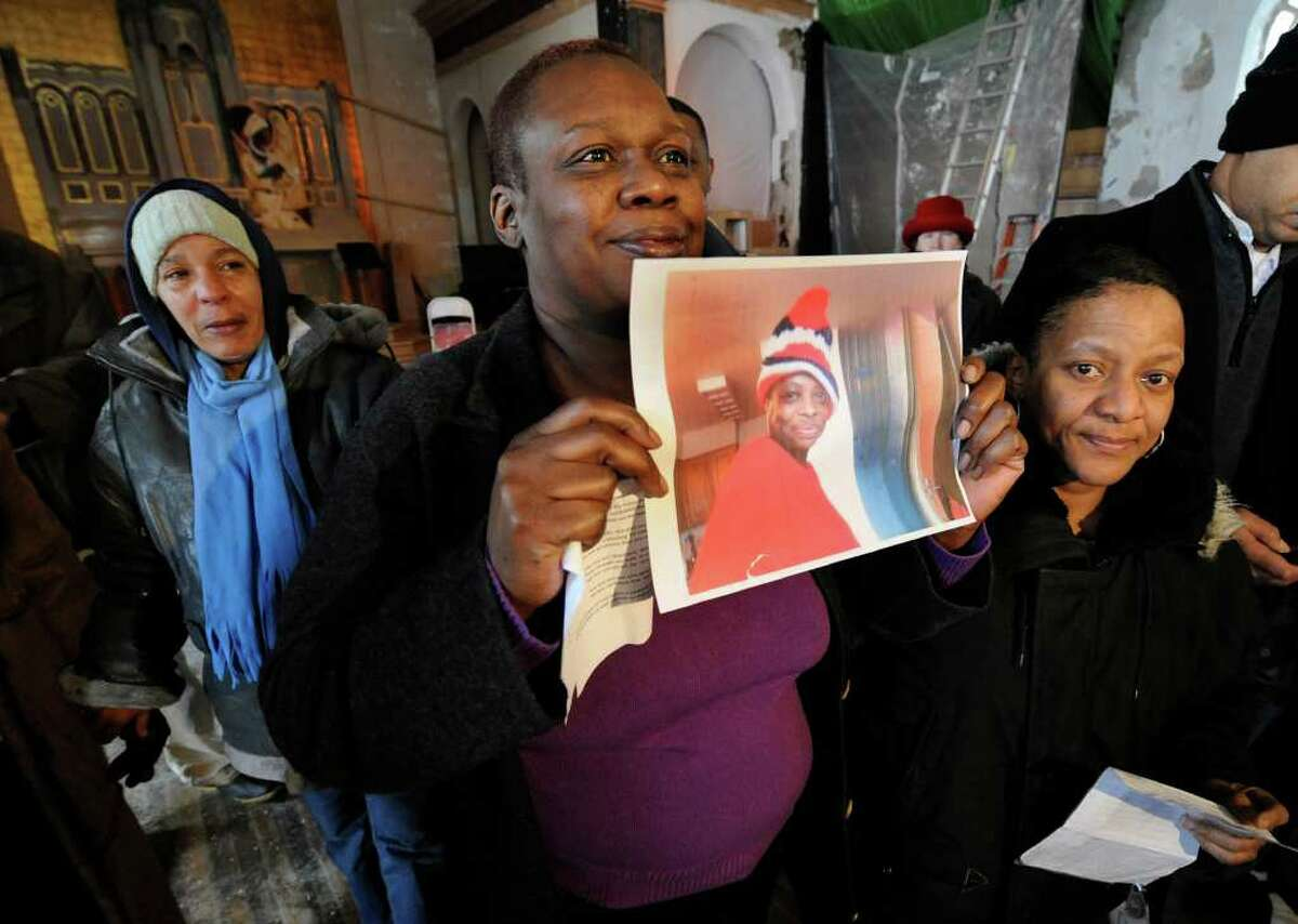 Stacey Monroe holds an image of Trina McDowell who perished in a fire at 69 Grand Street this week as she is remembered in a memorial at the Grand Street Community Arts building in Albany, New York February 25, 2011.(Skip Dickstein / Times Union)