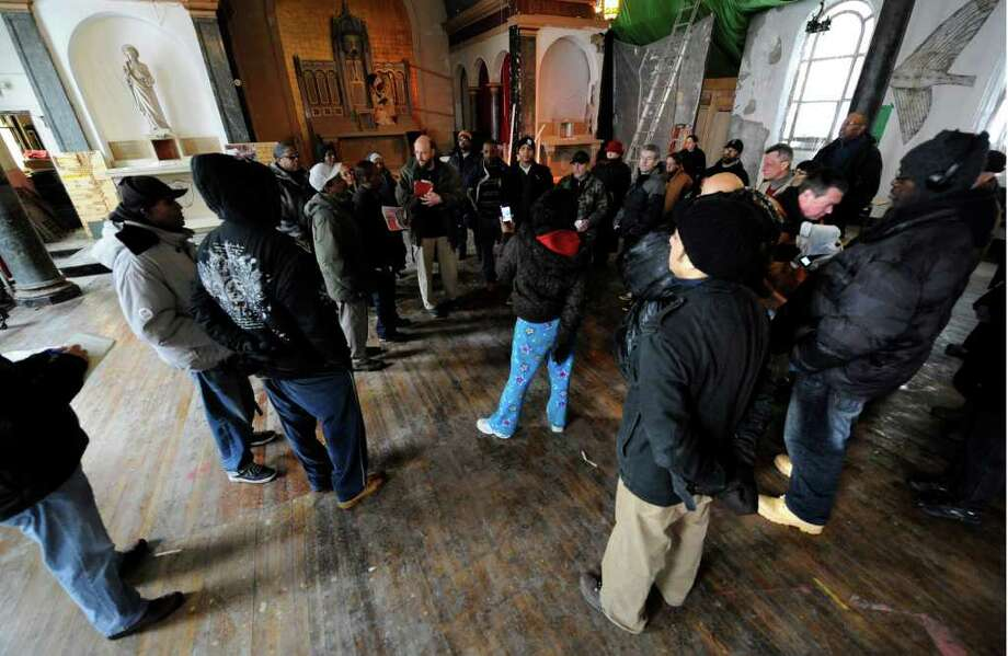 Friends and neighbors gather at the Grand Street Community Arts building on February 25, 2011 to remember Trina McDowell, who perished in a fire on Monday at 69 Grand St. in Albany. (Skip Dickstein / Times Union) Photo: Skip Dickstein
