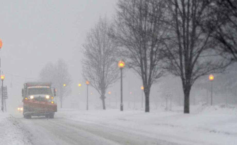 A Saratoga Springs plow travels north on Broadway in the city during a snow storm that hit the area February 25, 2011.   (Skip Dickstein / Times Union) Photo: Skip Dickstein / 2008