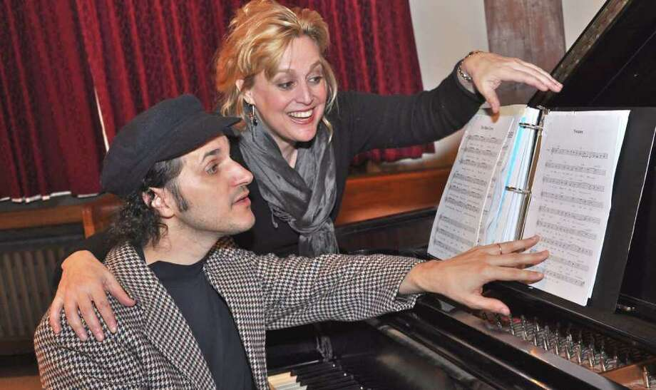 Chris Coogan and Michele Grace rehearse their music for the March 11 event. Photo: Contributed Photo / New Canaan News