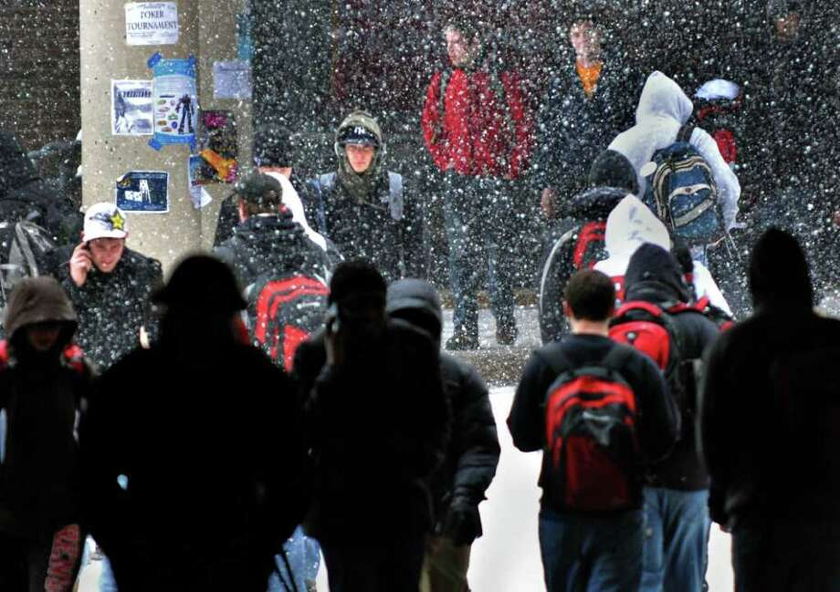 RPI students make their way to class in a snowstorm Friday afternoon Feb. 25, 2011, in Troy.  (John Carl D'Annibale / Times Union) Photo: John Carl D'Annibale / 00012200A