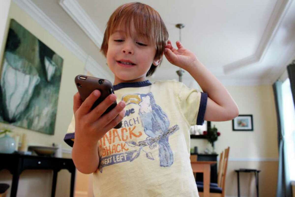 Evan Tedesco, 6, of Shelton uses the iPrompt application designed by his parents for children with autism.