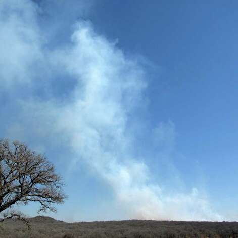 A wild fire southeast of Seguin on February 12 produced a smoke plume so large it was visible from space. Photograph by Forrest M. Mims III. Photo: FORREST M MIMS 111