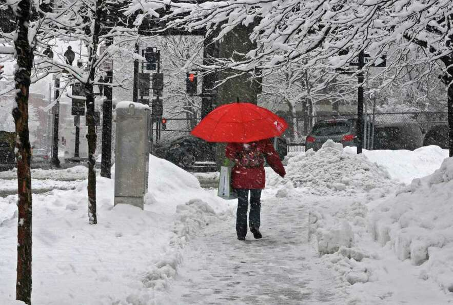 A woman walks with an umbrella during a snow storm in Albany, NY on Friday, February 25, 2011.  (Lor