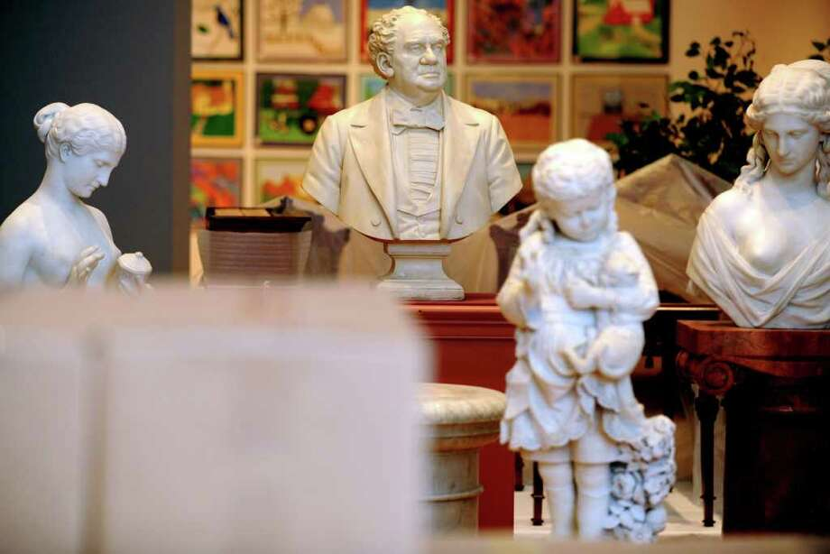 Marble busts, including one of P.T. Barnum, sit in the center of the first floor of The Barnum Museum awaiting relocation during restoration of the historic building following damage to its structure during the June 24, 2010 tornado. Photo: Autumn Driscoll / Connecticut Post