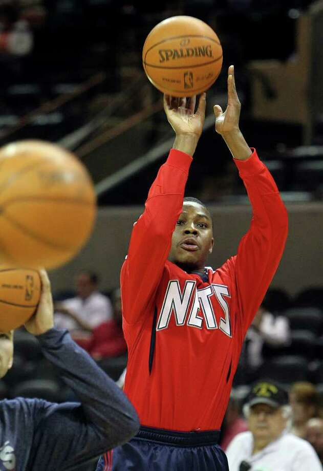 Warren graduate Ben Uzoh and current New Jersey Net guard shoots during warmups before the game against the Spurs at the AT&T Center on Friday, Feb. 25, 2011. Kin Man Hui/kmhui@express-news.net Photo: KIN MAN HUI, SAN ANTONIO EXPRESS-NEWS / kmhui@express-news.net