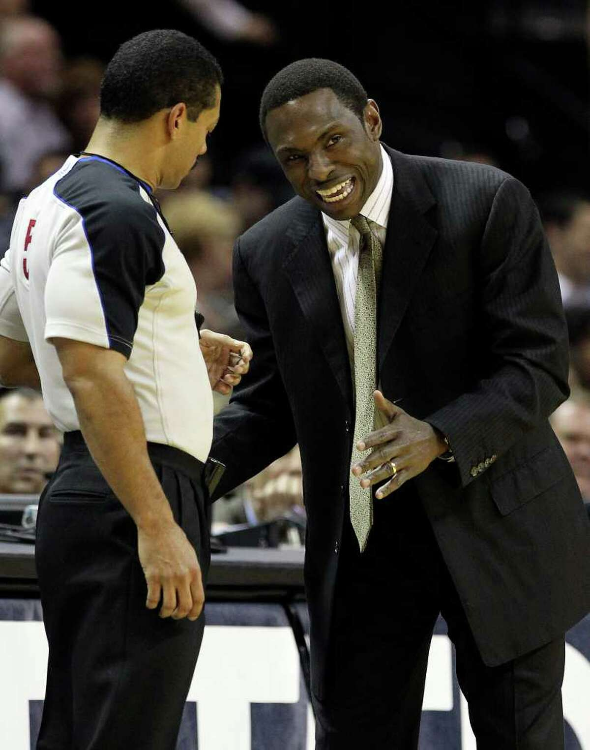 New Jersey Nets coach Avery Johnson (right) debates a call with official Bill Kennedy in the first half at the AT&T Center on Friday, Feb. 25, 2011. Kin Man Hui/kmhui@express-news.net