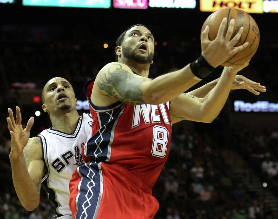 New Jersey Nets' Deron Williams (08) gets fouled by Spurs' George Hill in the second half at the AT&T Center on Friday, Feb. 25, 2011. Spurs defeated the Nets, 106-96. Kin Man Hui/kmhui@express-news.net Photo: KIN MAN HUI, SAN ANTONIO EXPRESS-NEWS / kmhui@express-news.net