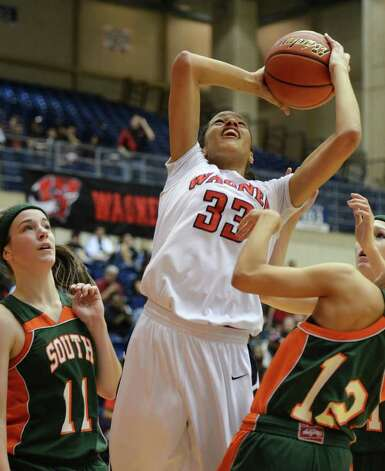 Wagner senior Arielle Roberson (33) takes a shot between two Harlingen defenders during the Region IV-5A girls semifinal basketball game between the Wagner T-Birds and the Harlingen South in the UTSA Convocation Center in San Antonio, Texas on February 25, 2011  John Albright / Special to the Express-News. Photo: JOHN ALBRIGHT, San Antonio Express-News / San Antonio Express-News