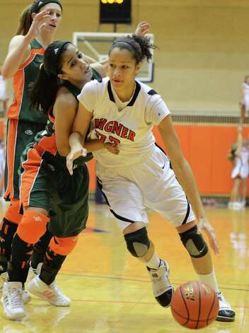 Wagner senior Arielle Roberson (33) drives the ball past two Harlingen defenders during the Region IV-5A girls semifinal basketball game between the Wagner T-Birds and the Harlingen South in the UTSA Convocation Center in San Antonio, Texas on February 25, 2011  John Albright / Special to the Express-News. Photo: JOHN ALBRIGHT, San Antonio Express-News / San Antonio Express-News