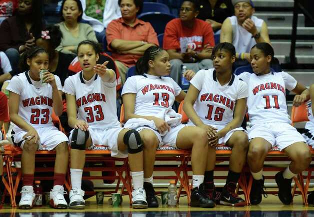Wagner's starters sit on the bench near the end of their 66-51 victory over Harlingen South during the Region IV-5A girls semifinal basketball game between the Wagner T-Birds and the Harlingen South in the UTSA Convocation Center in San Antonio, Texas on February 25, 2011  John Albright / Special to the Express-News. Photo: JOHN ALBRIGHT, San Antonio Express-News / San Antonio Express-News