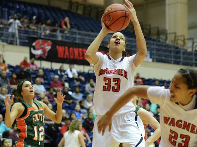 Wagner senior Arielle Roberson (33) takes a shot during the Region IV-5A girls semifinal basketball game between the Wagner T-Birds and the Harlingen South in the UTSA Convocation Center in San Antonio, Texas on February 25, 2011  John Albright / Special to the Express-News. Photo: JOHN ALBRIGHT, San Antonio Express-News / San Antonio Express-News