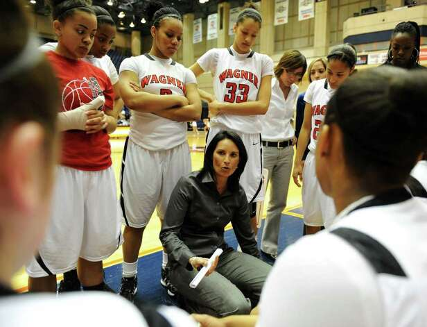 Wagner head coach Christina Camacho talks to her team during a time out during the Region IV-5A girls semifinal basketball game between the Wagner T-Birds and the Harlingen South in the UTSA Convocation Center in San Antonio, Texas on February 25, 2011  John Albright / Special to the Express-News. Photo: JOHN ALBRIGHT, San Antonio Express-News / San Antonio Express-News