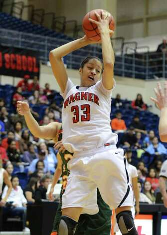 Wagner senior Arielle Roberson (33) grabs a rebound during the Region IV-5A girls semifinal basketball game between the Wagner T-Birds and the Harlingen South in the UTSA Convocation Center in San Antonio, Texas on February 25, 2011  John Albright / Special to the Express-News. Photo: JOHN ALBRIGHT, San Antonio Express-News / San Antonio Express-News