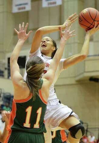 Wagner senior Arielle Roberson (33) takes a shot over Harlingen South senior Taylor Key (11) during the Region IV-5A girls semifinal basketball game between the Wagner T-Birds and the Harlingen South in the UTSA Convocation Center in San Antonio, Texas on February 25, 2011  John Albright / Special to the Express-News. Photo: JOHN ALBRIGHT, San Antonio Express-News / San Antonio Express-News