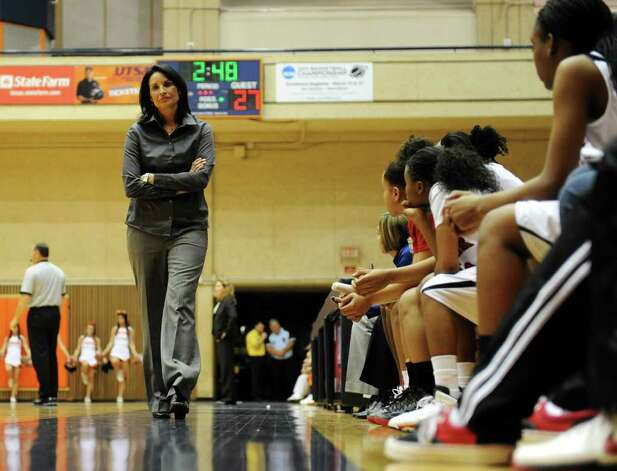 Wagner head coach Christina Camacho paces infront of her bench during the Region IV-5A girls semifinal basketball game between the Wagner T-Birds and the Harlingen South in the UTSA Convocation Center in San Antonio, Texas on February 25, 2011  John Albright / Special to the Express-News. Photo: JOHN ALBRIGHT, San Antonio Express-News / San Antonio Express-News