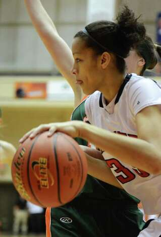 Wagner senior Arielle Roberson (33) dribbles past a Harlingen defender during the Region IV-5A girls semifinal basketball game between the Wagner T-Birds and the Harlingen South in the UTSA Convocation Center in San Antonio, Texas on February 25, 2011  John Albright / Special to the Express-News. Photo: JOHN ALBRIGHT, San Antonio Express-News / San Antonio Express-News