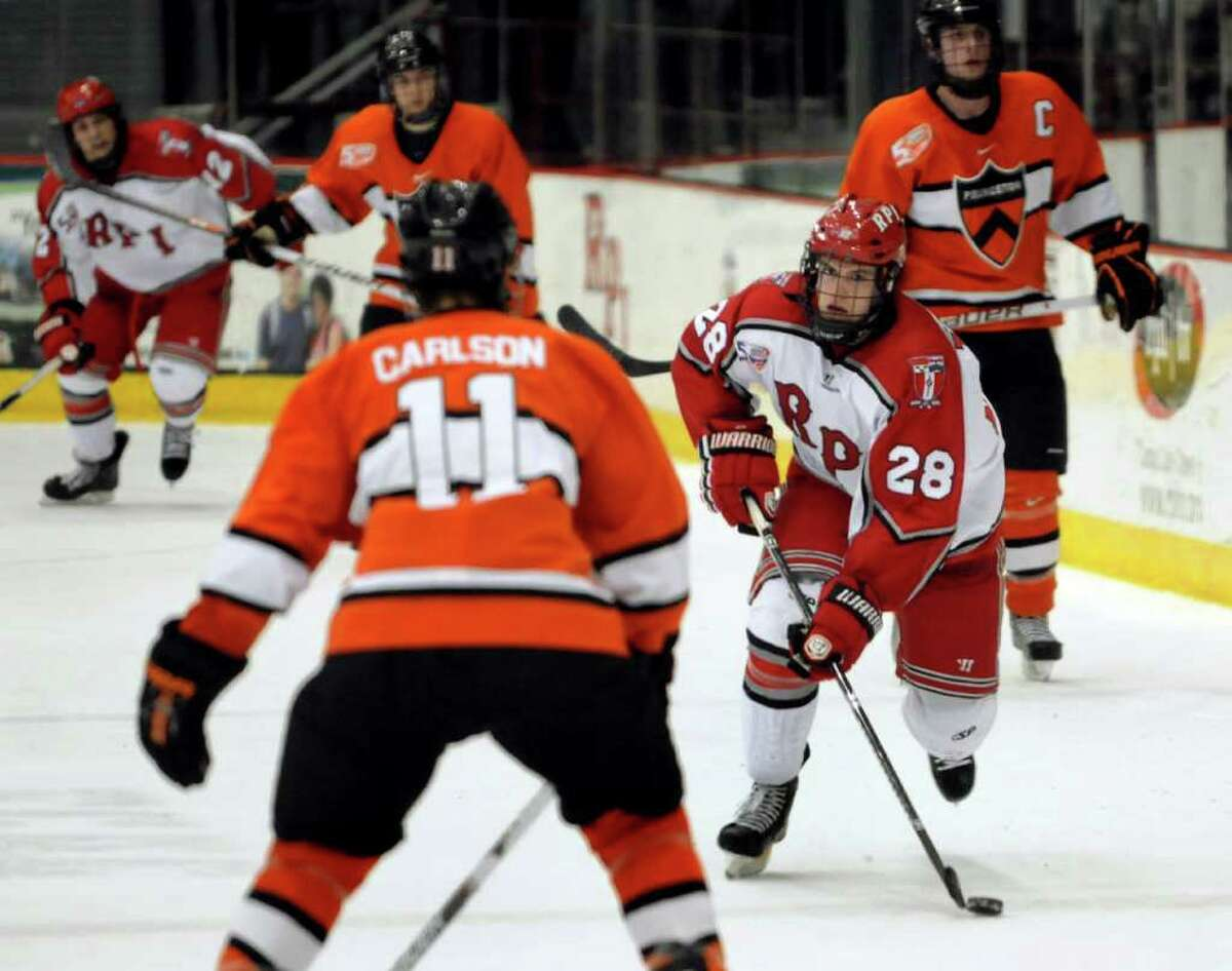 RPI's Matt Tinordi (28), right, controls the puck as Princeton's Eric Carlson (11) defends during their hockey game on Friday, Feb. 25, 2011, at Rensselaer Polytechnic Institute in Troy, N.Y. (Cindy Schultz / Times Union)