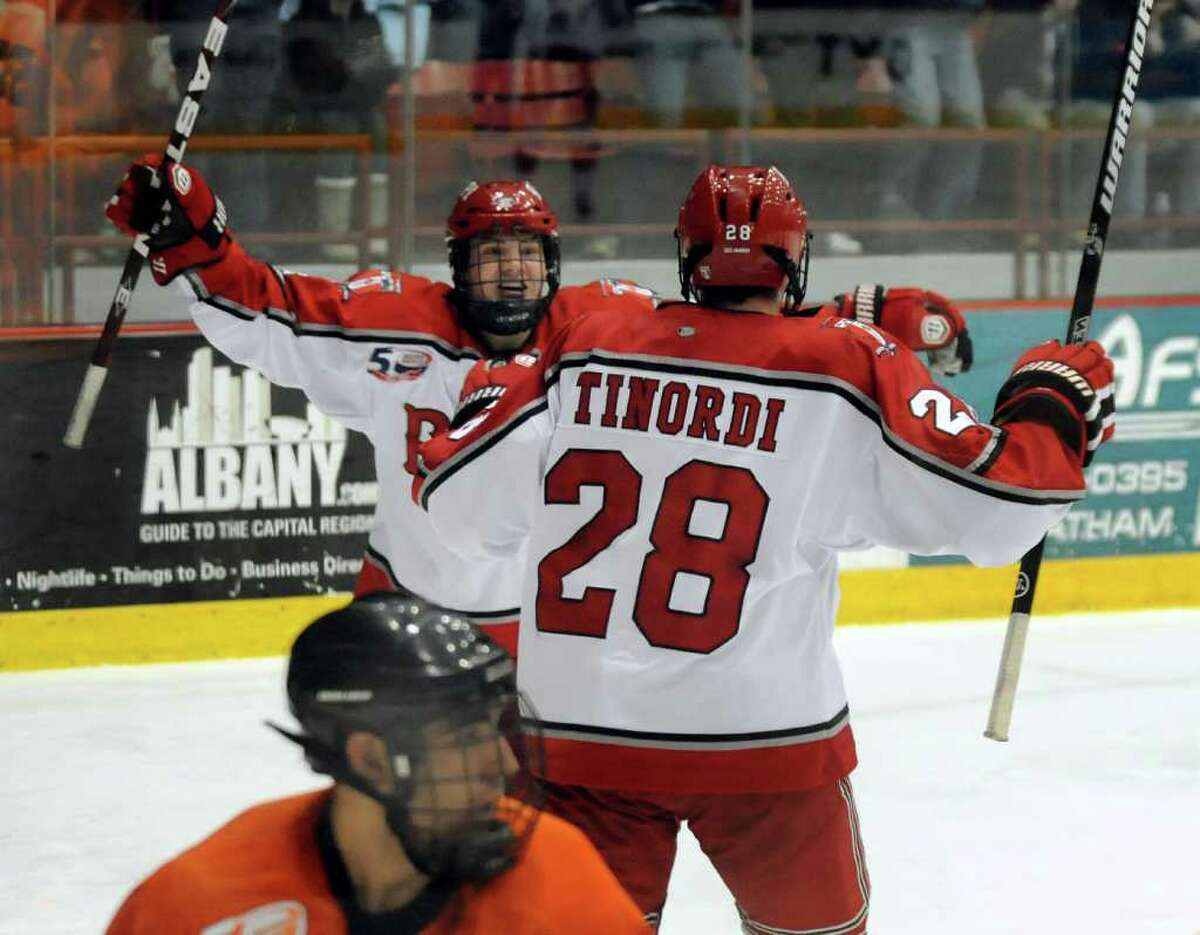 RPI's Matt Tinordi (28), right, celebrates his second-period goal, making the score 2-3, with teammate Bryan Brutlag (4) during their hockey game against Princeton on Friday, Feb. 25, 2011, at Rensselaer Polytechnic Institute in Troy, N.Y. (Cindy Schultz / Times Union)