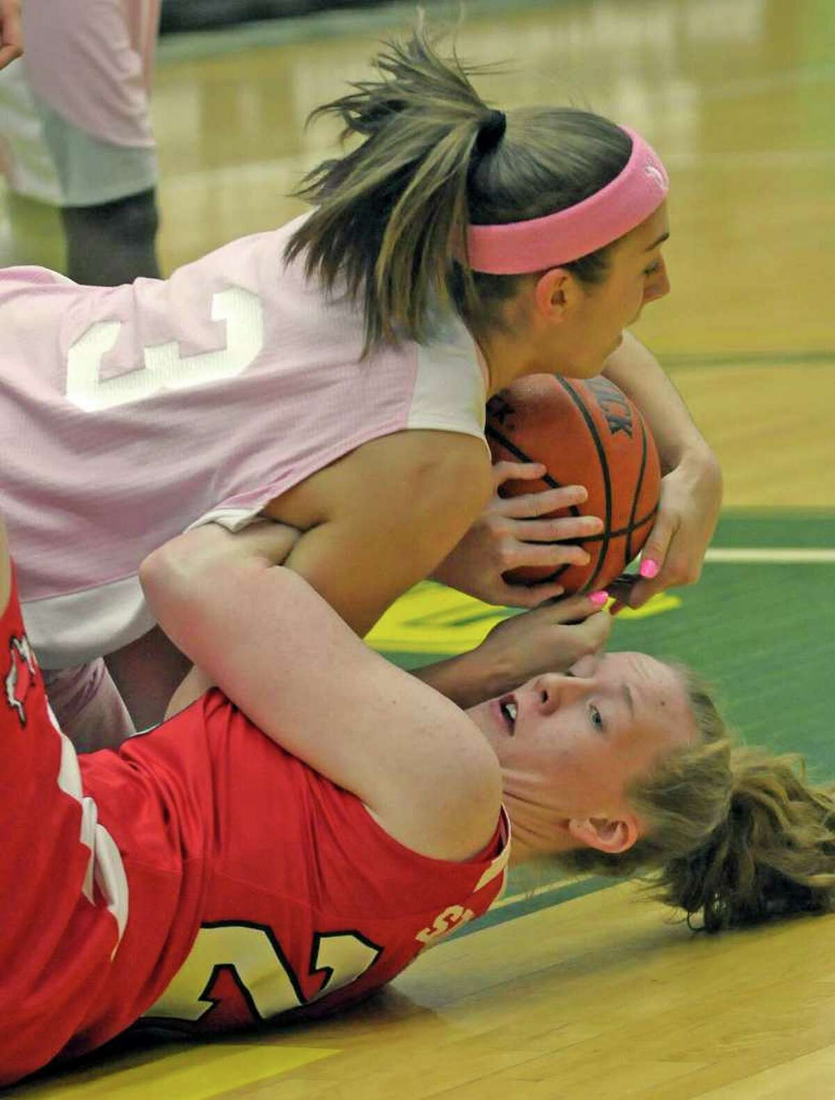 Siena's Brittany Wilwohl ,top, and Marist's Emily Stalling battle for the ball during their basketball game at Siena College in Loudonville, N.Y., Friday Feb. 25, 2011. (Hans Pennink / Special to the Times Union) College Sports