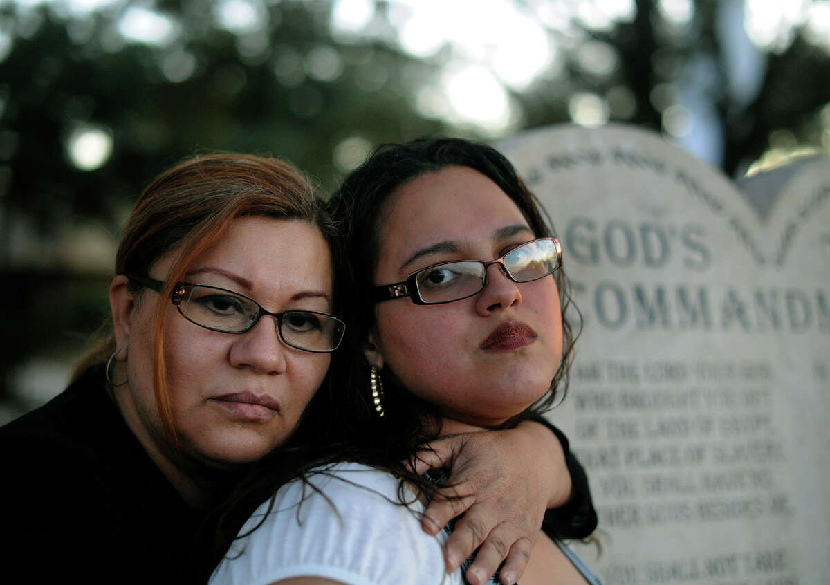Rosio Castro (right) with her mother, Patricia Castro, on the grounds of St. John Berchmans Catholic Church. Rosio Castro says she was repeatedly raped by Father Theo A. Clerx, who died seven years ago.