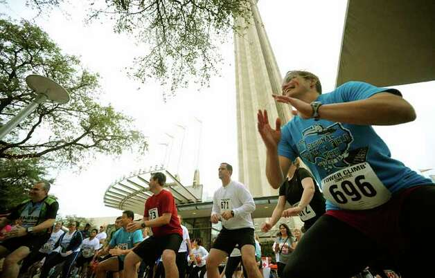 "Jackie Smyth and others warm up before the Cystic Fibrosis Foundation ""Climb & Run"" at the Tower of the Americas on Saturday, Feb. 26, 2011. BILLY CALZADA / gcalzada@express-news.net"