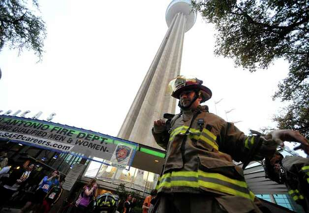 "San Antonio firefighter Roger Lopez prepares to climb the Tower of the Americas during the Cystic Fibrosis Foundation ""Climb & Run"" on Saturday, Feb. 26, 2011. Several firefighters and police officers climbed wearing full gear, which weighs about 60 lbs. BILLY CALZADA / gcalzada@express-news.net"