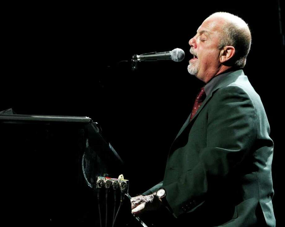 Billy Joel performs onstage at the Honda Center in 2009 in Anaheim, California. Photo: File Photo / Greenwich Time File Photo