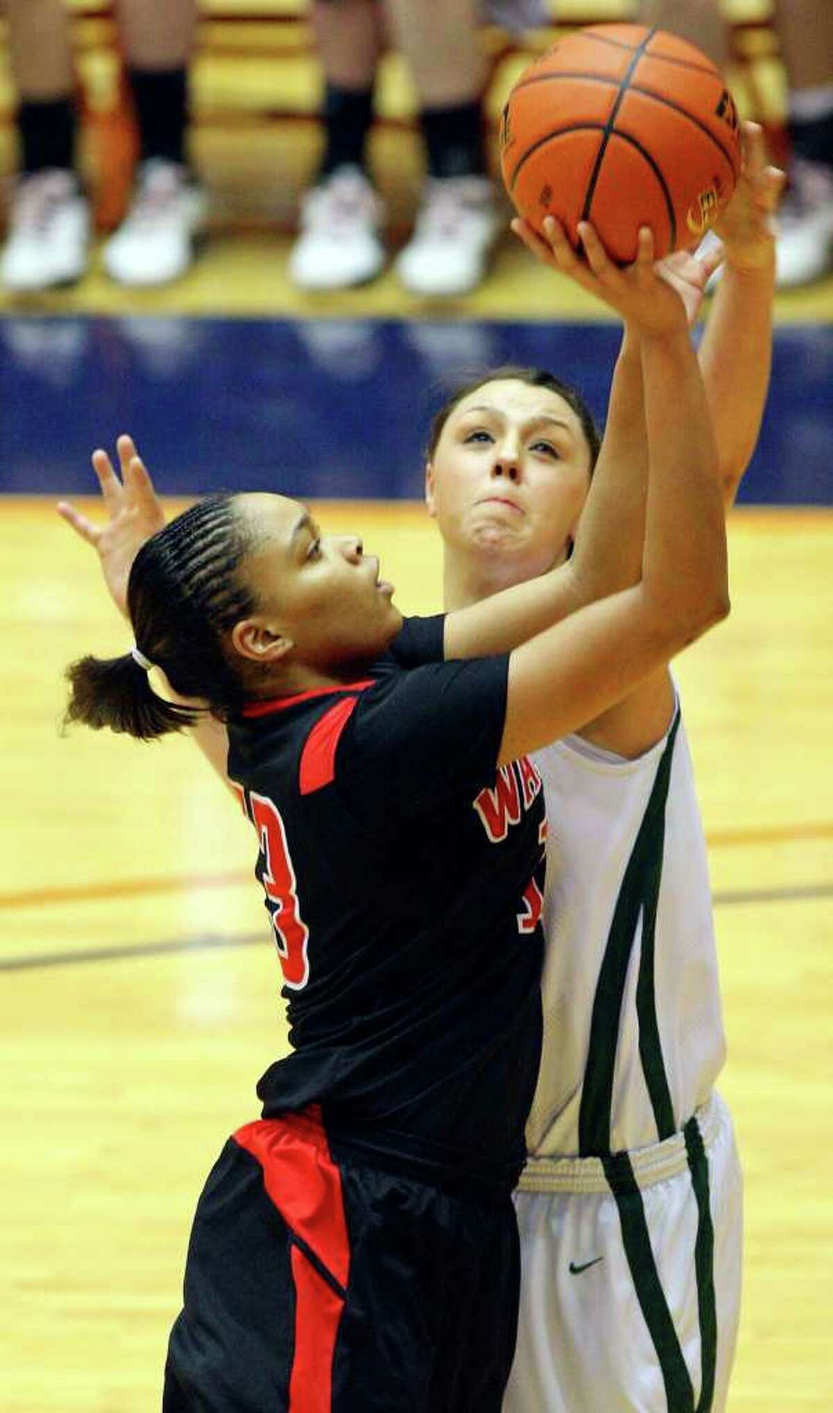 FOR SPORTS - Wagner's Kiara Rivera has her shot blocked by Corpus Christi King's Dempsey Thornton during first half action of the Region IV-5A final Saturday Feb. 26, 2011 at the UTSA Convocation Center. (PHOTO BY EDWARD A. ORNELAS/eaornelas@express-news.net)