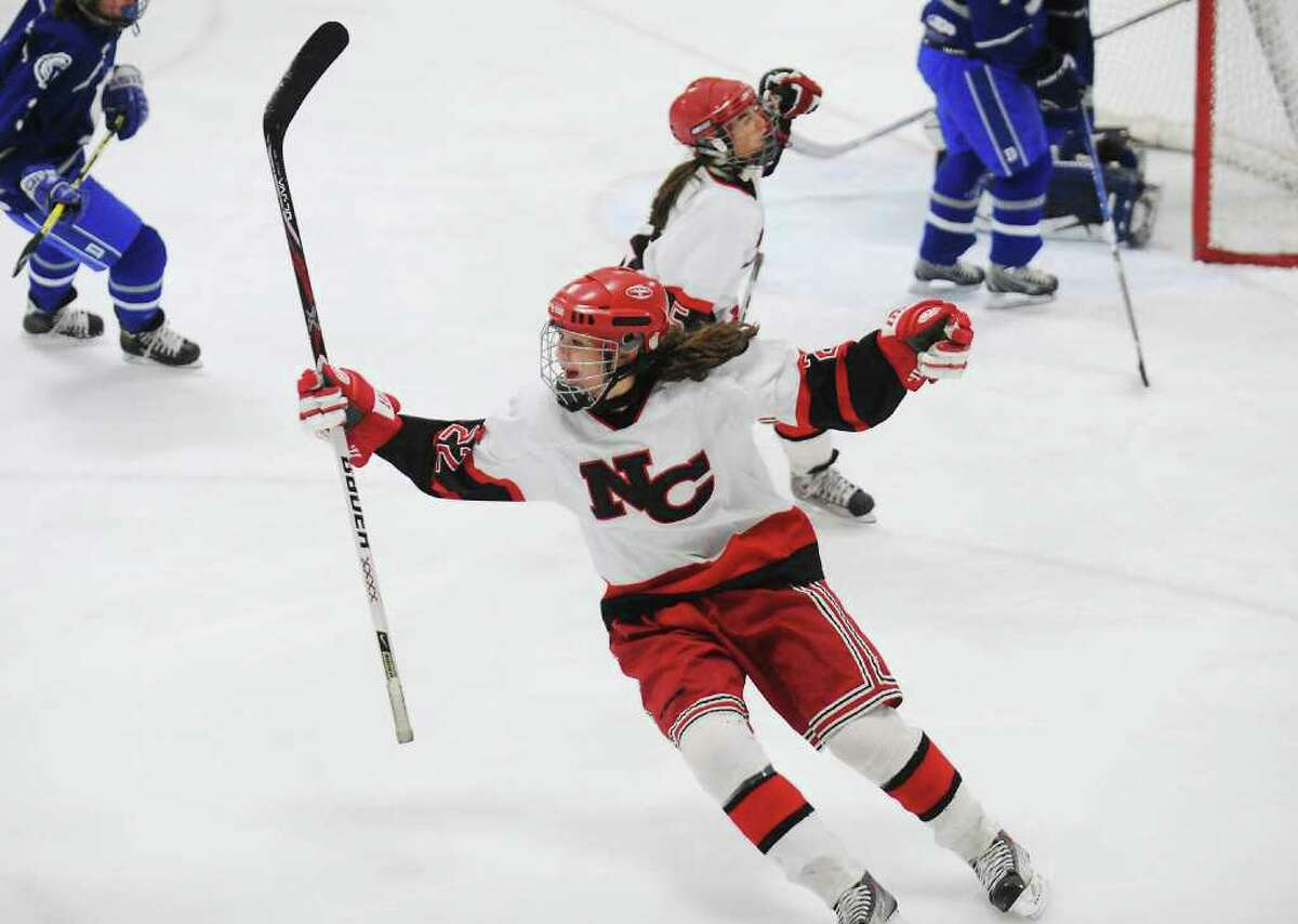 New Canaan High School's Olivia Hompe celebrates after scoring against Darien High School in the girls hockey FCIAC championship game at Terry Conners Rink in Stamford, Conn. on Saturday February 26, 2011. New Canaan won 7-1.