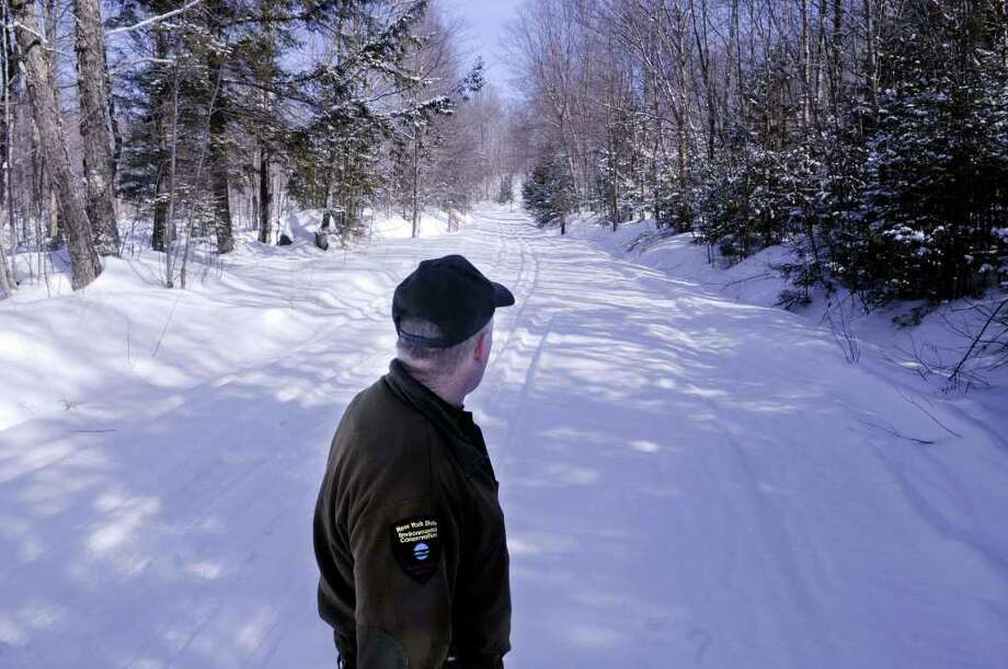 DEC Ranger Tom Eakin   at the start of Fly creek Rd., a logging road that is also a snowmobile trail in the town of Speculator   on Monday, Feb. 21, 2011  (Paul Buckowski / Times Union) Photo: Paul Buckowski  / 00012138A