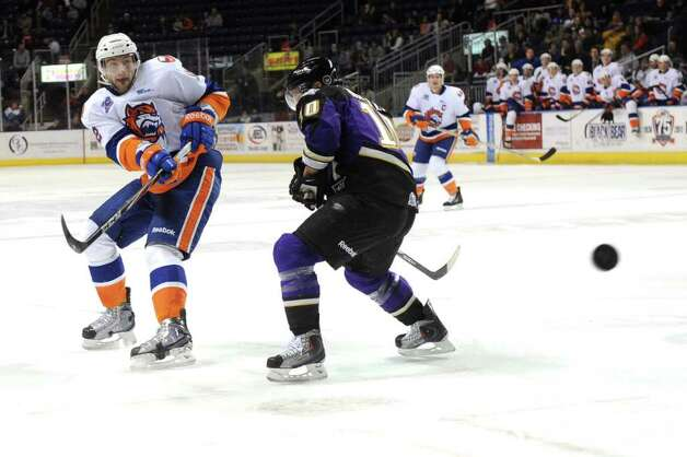 Bridgeport's Tomas Marcinko passes the puck past Manchester's Oscar Moller during Saturday's game at Webster Bank Arena at Harbor Yard on February 26, 2011. Photo: Lindsay Niegelberg / Connecticut Post