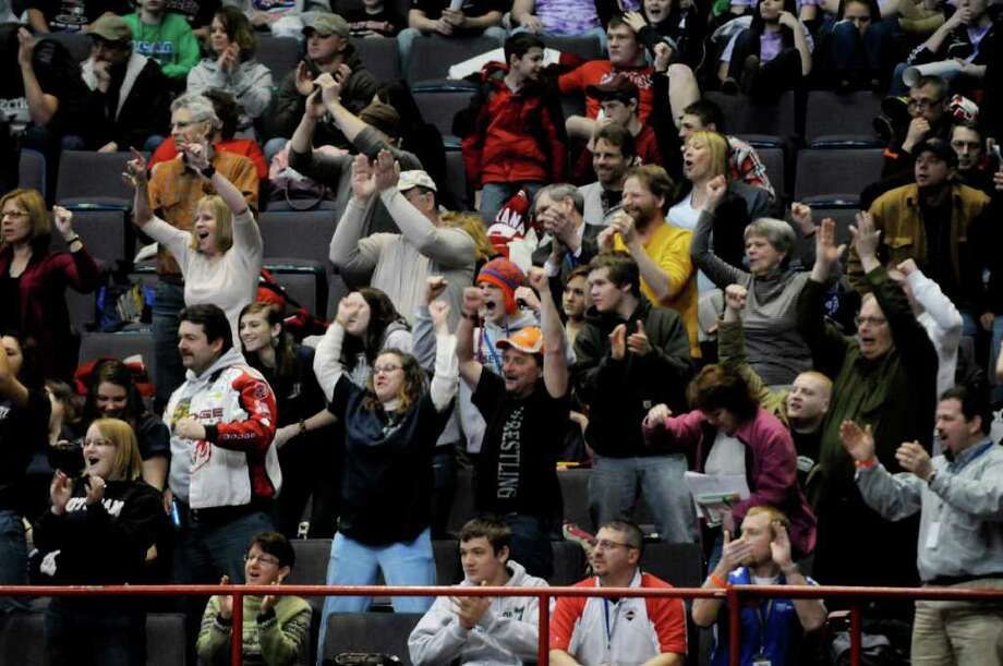 Fans cheer during the Sem-Finals of 2011 NYSPHSAA Wrestling Championships at the Times Union Center in Albany Saturday Feb. 26, 2011.( Michael P. Farrell/Times Union ) Photo: Michael P. Farrell