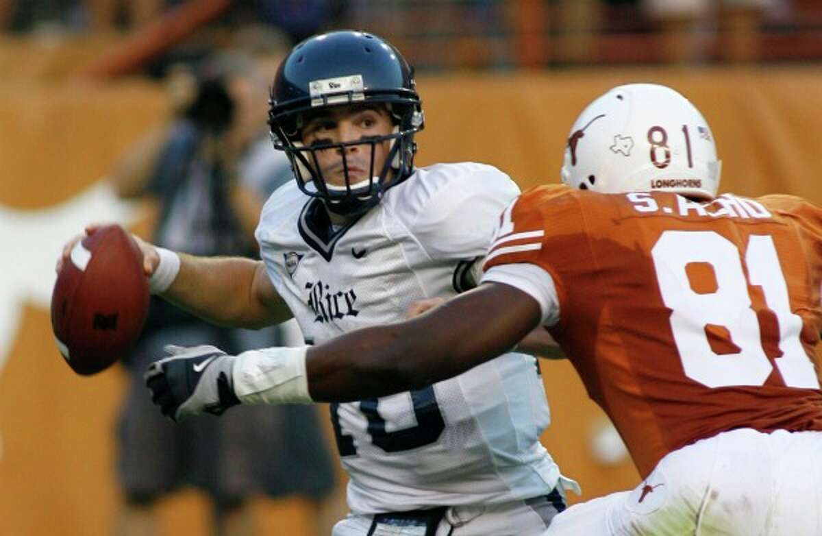 Texas' Sam Acho puts pressure on Rice quarterback Chase Clement during the 2008 season. (Harry Cabluck/Associated Press)