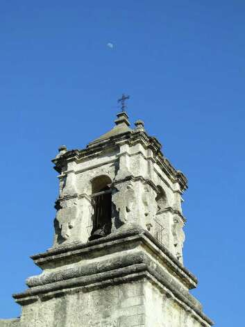 The moon shines in a crisp afternoon sky above Mission San José. Photo: Tracy Hobson Lehmann