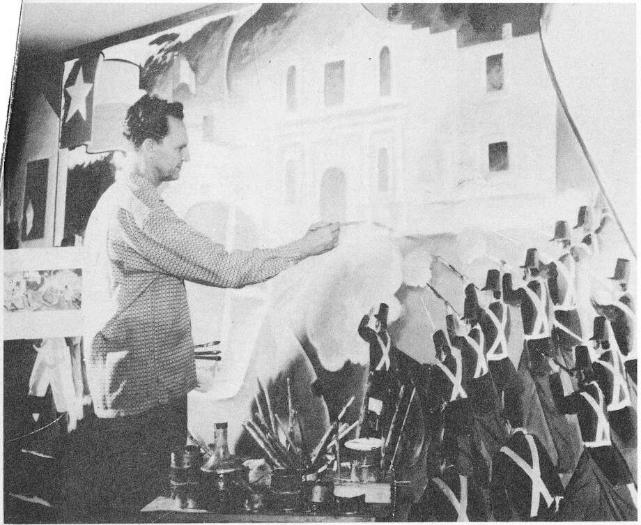 Mural artist Eugene Montgomery works on one of a series of Texas history murals that were commissioned for a Sears store on the South Side in 1954. COURTESY DRT LIBRARY