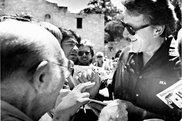 """James Arness talks to fans in front of the Alamo. He played Jim Bowie in the TV movie """"The Alamo: 13 Days to Glory."""" FILE PHOTO"""