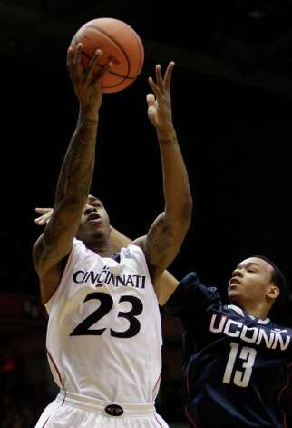 Cincinnati guard Sean Kilpatrick (23) drives against Connecticut guard Shabazz Napier (13) in the first half of an NCAA college basketball game, Sunday, Feb. 27, 2011, in Cincinnati. (AP Photo/Al Behrman) Photo: Al Behrman, ASSOCIATED PRESS / ASSOCIATED PRESS
