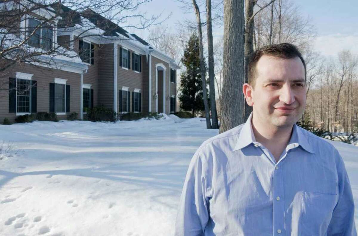 Steven Coury at his new home on Encampment Place in Ridgefield. He sold his home and is now renting this house for half the cost of his old mortgage. Wednesday, Feb. 17, 2011