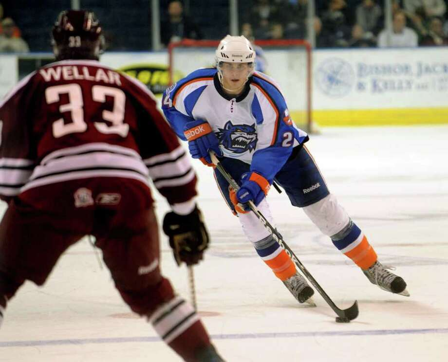 Sound Tigers #24 David Ulstrom drives the puck towards Hershey's #33 Patrick Wellar, during hockey action at the Webster Bank Arena in Bridgeport, Conn. on Sunday February 27, 2011. Photo: Christian Abraham / Connecticut Post