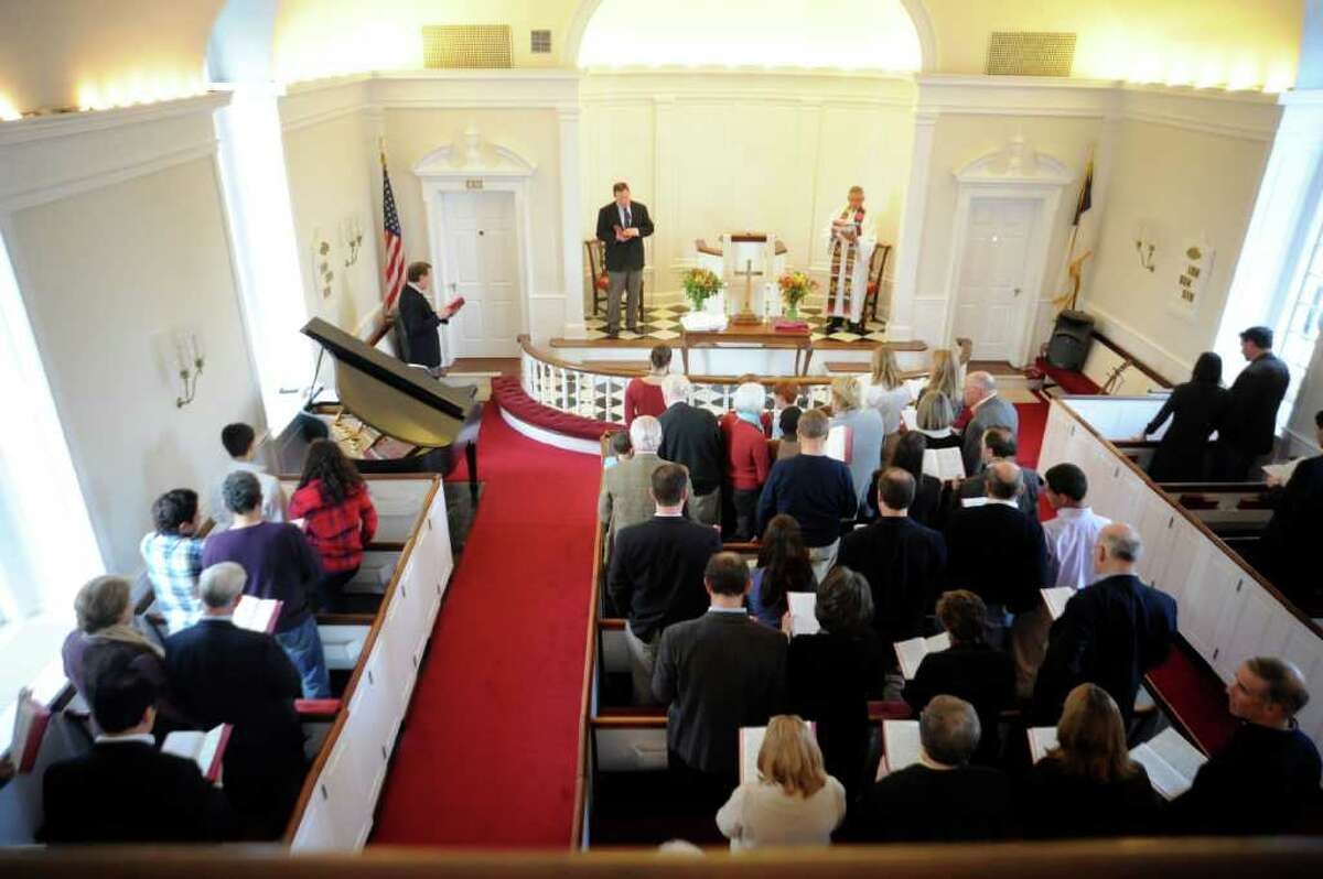 The installion of Sean Witty, center, as assistant pastor of the First Church of Round Hill on Sunday, Feb. 27, 2011.