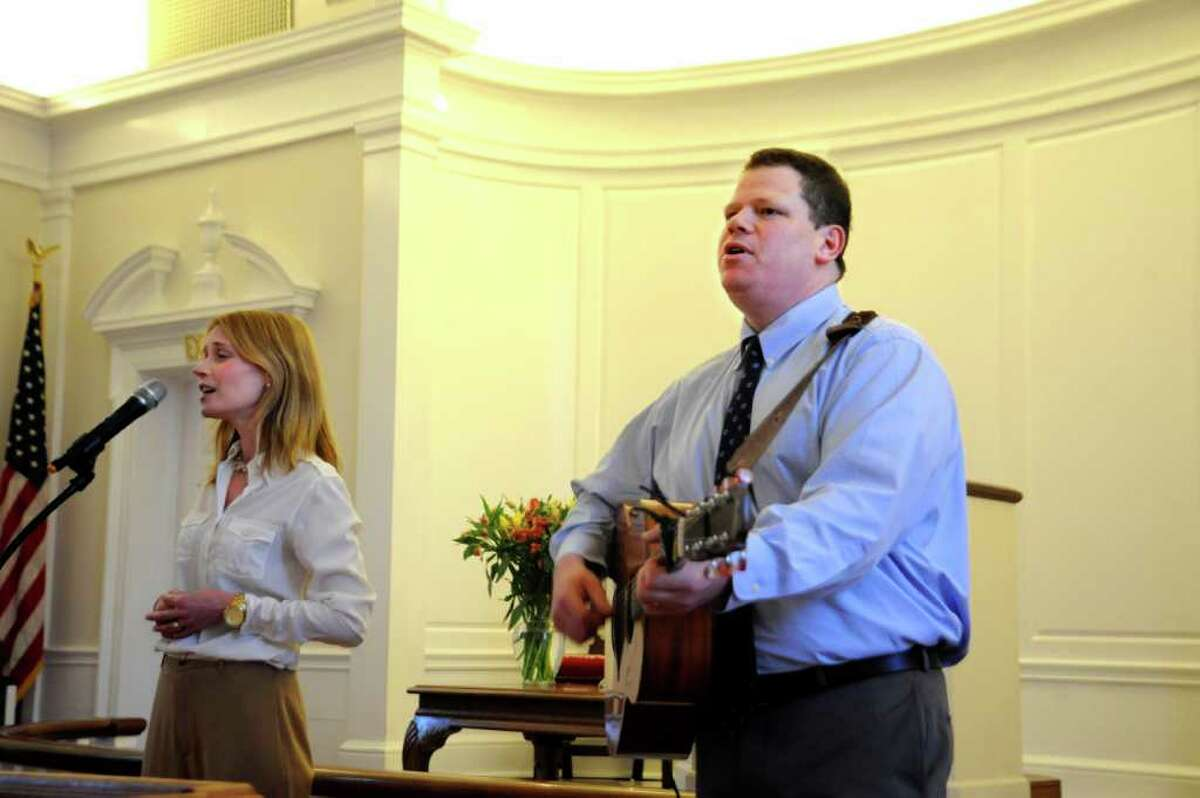 Lynn Witty and and her husband Sean sing at his installation at the First Church of Round Hill on Sunday, Feb. 27, 2011.