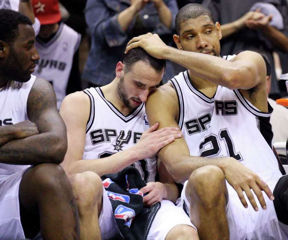 FOR SPORTS - Spurs' DeJuan Blair (from left) looks on as Spurs' Manu Ginobili is congratulated by teammate Spurs' Tim Duncan in the final seconds of the game with the  Grizzlies Sunday Feb 27, 2011 at the AT&T Center. The Spurs won 95-88. (PHOTO BY EDWARD A. ORNELAS/eaornelas@express-news.net) Photo: EDWARD A. ORNELAS, SAN ANTONIO EXPRESS-NEWS / eaornelas@express-news.net