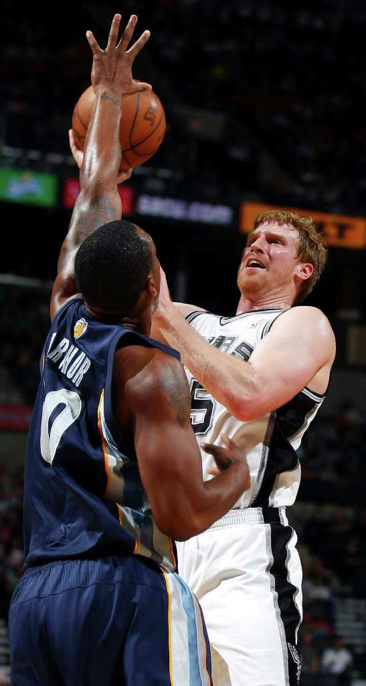 FOR SPORTS - Spurs' Matt Bonner shoots over Grizzlies' Darrell Arthur during second half action Sunday Feb 27, 2011 at the AT&T Center. The Spurs won 95-88. (PHOTO BY EDWARD A. ORNELAS/eaornelas@express-news.net)
