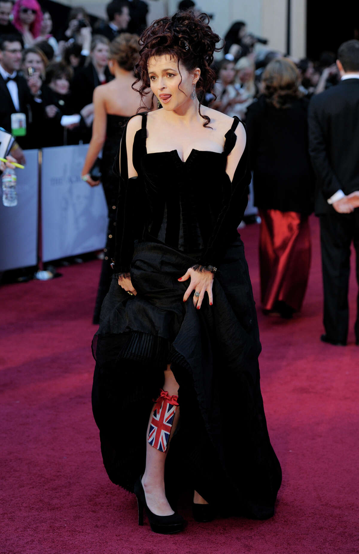 Helena Bonham-Carter. We had a cat do that to our sleeves once, too. Commentary by the Houston Chronicle's Kyrie O'Connor of the MeMo blog. Photo by the Associated Press.