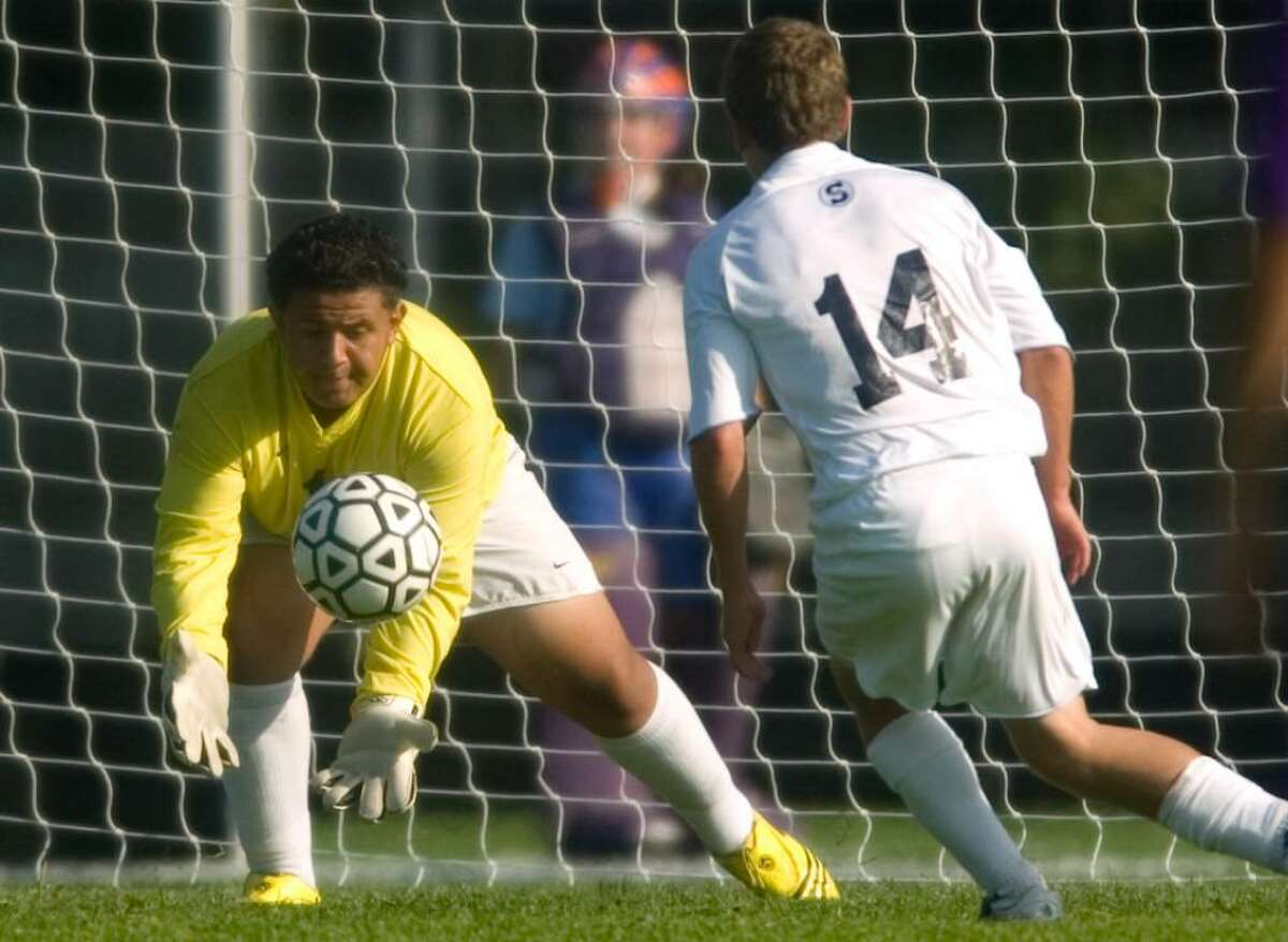 Westhill High School goalie Lydin Gonzalez makes a save during an FCIAC soccer match at Staples High School on Tuesday, Sept. 15, 2009.