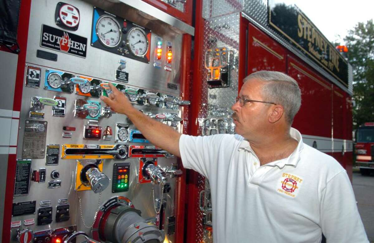 Chief Mike Klemish explains the features of Stepney Volunteer Fire Company's new 2009 pumper truck with a state-of-the-art pump panel. This is one of six new trucks for the Monroe, Conn. fire company.